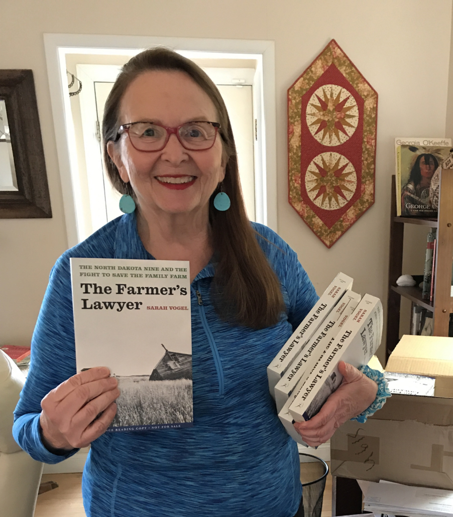 Sarah with a box full of The Farmer's Lawyer copies