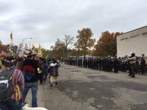 a wall of black uniformed militia